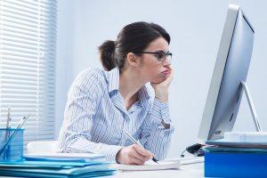 woman writing program funding proposal