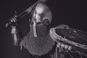Man in armor fighting retail fraud